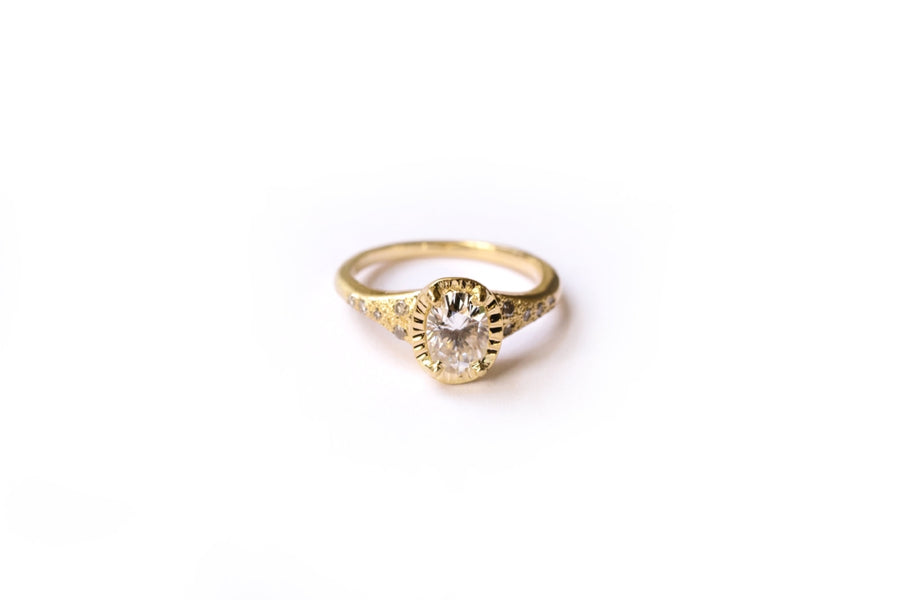 Oval Moissanite with a Hammered 14k Gold and Diamond Halo Engagement Ring