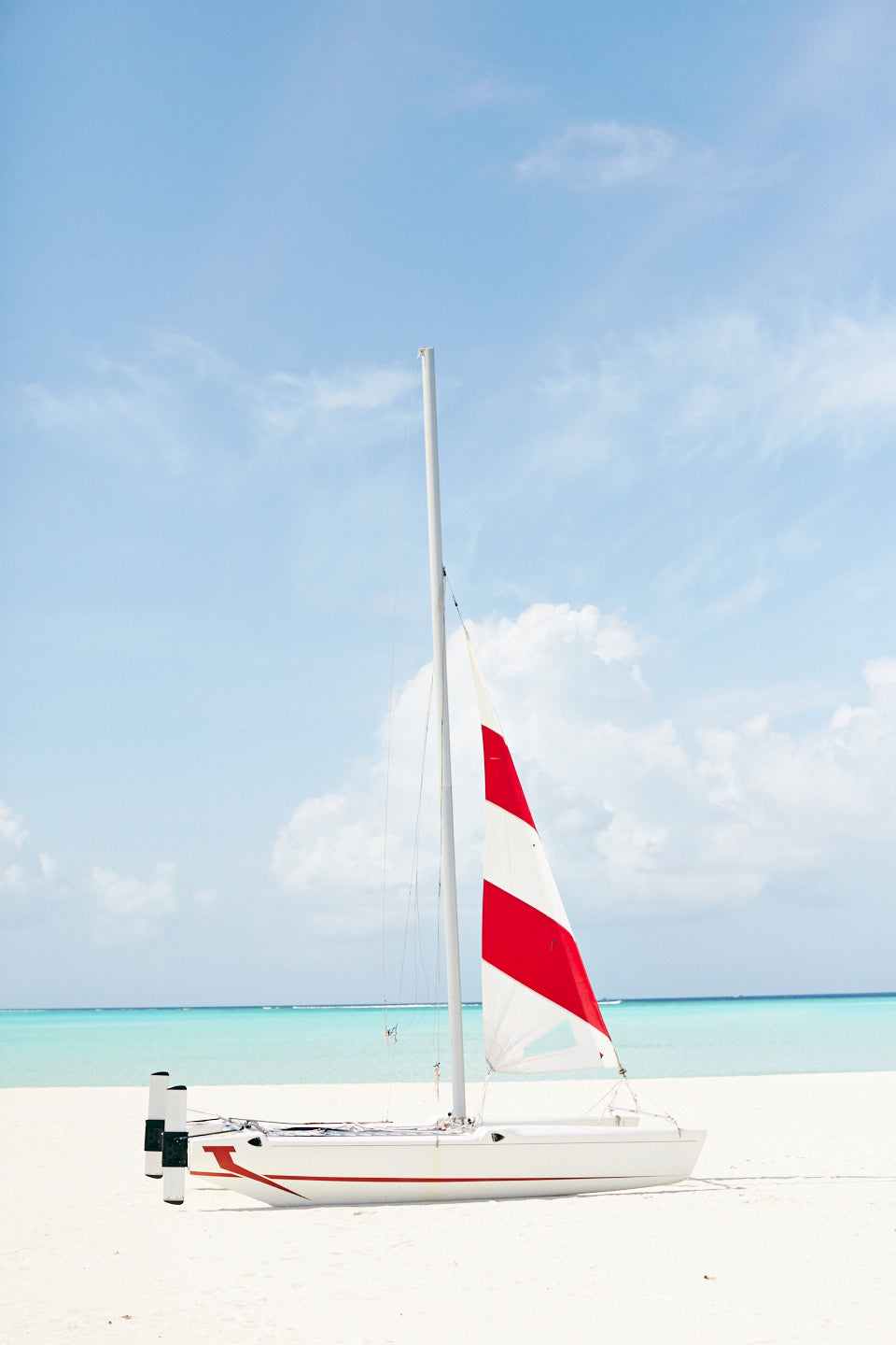 Red Striped sail with Catamaran, Cocoa Island, Maldives