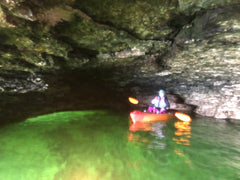 Milissa Kayaking in A Cave