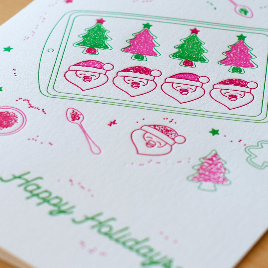 Christmas Cookies Letterpress Greeting Card - a closeup of the Christmas tree and Santa Claus sugar cookies being decorated