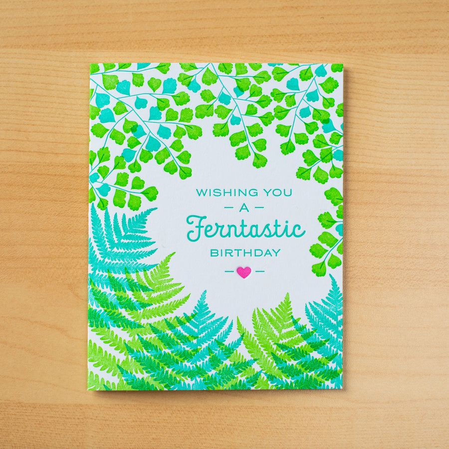Letterpress greeting card with green ferns around the words Wishing You a Ferntastic Birthday