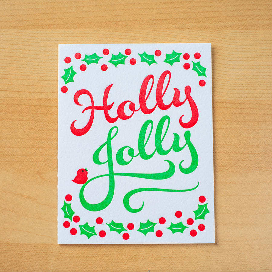 Letterpress holiday greeting card with the words Holly Jolly printed in green and red