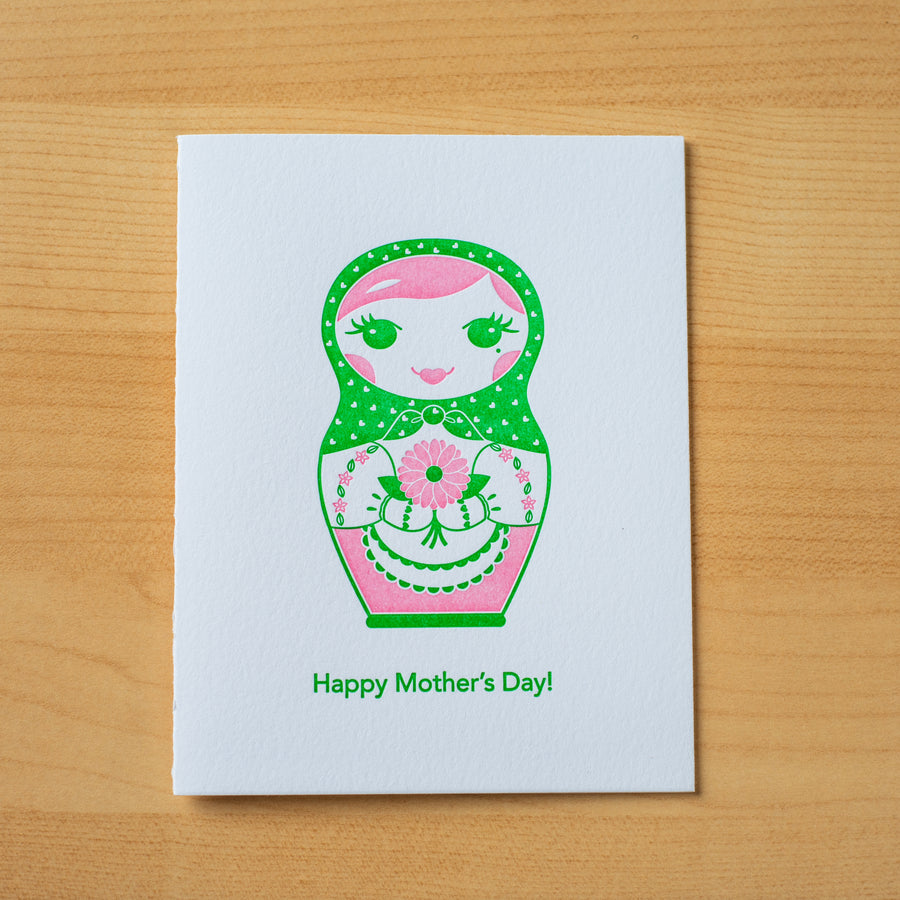 Letterpress Mother's Day greeting card of a nesting doll holding a bouquet of flowers