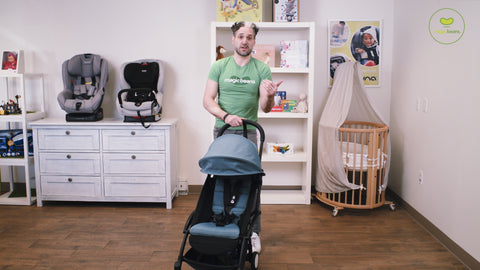 Man in green shirt standing with BABYZEN YOYO2 stroller