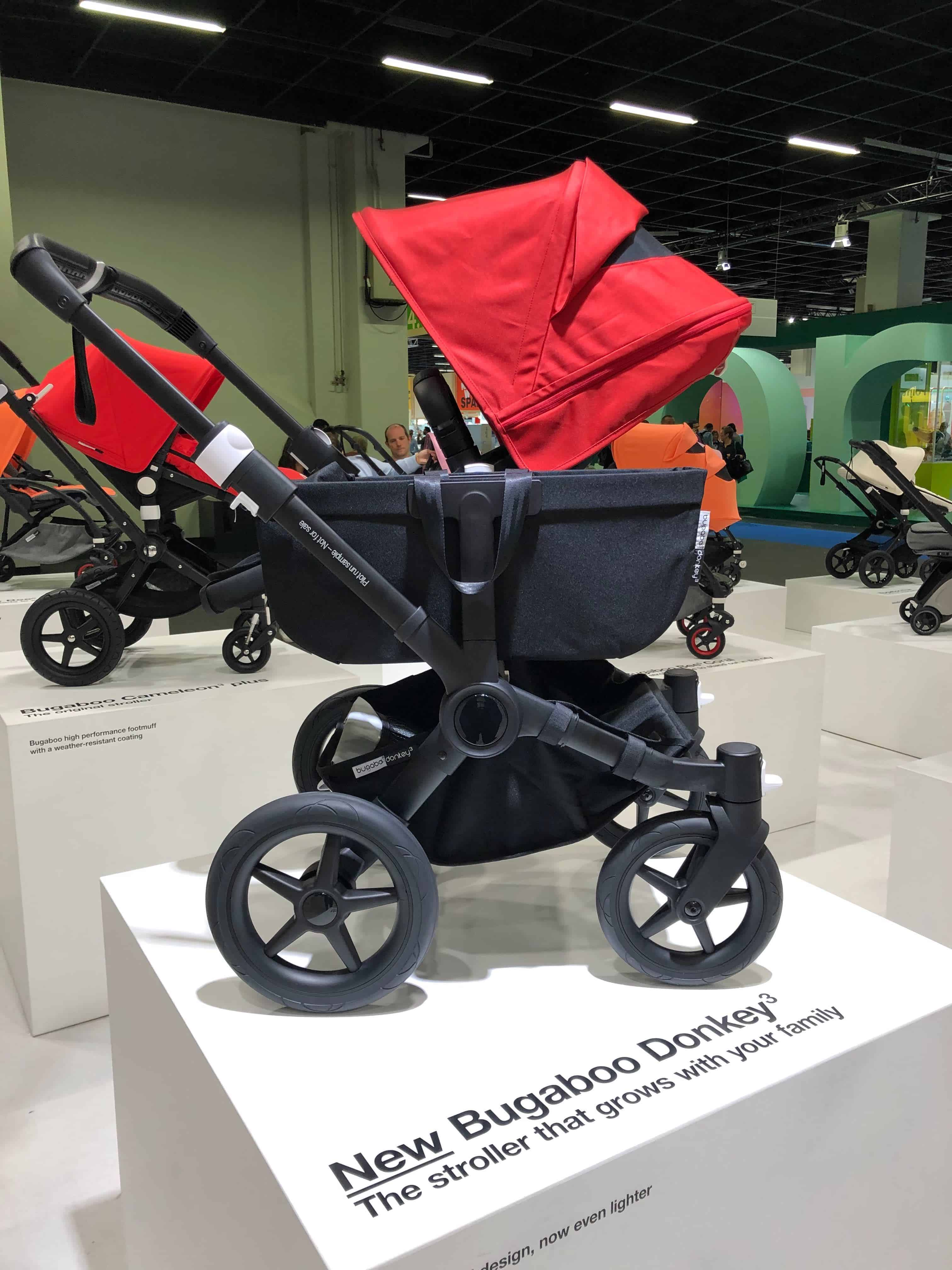 Red and black Bugaboo Donkey3 stroller against showroom background