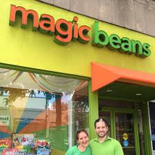 Eli and Sheri standing in front of the Magic Bean Brookline storefront