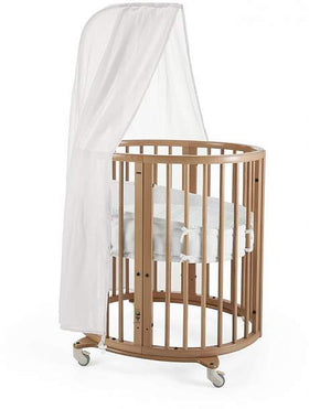 Brown and white Stokke bassinet