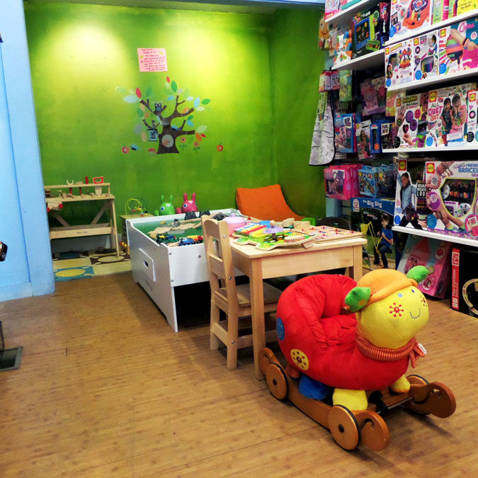 Magic Beans store interior, featuring shelves of toys and a play area