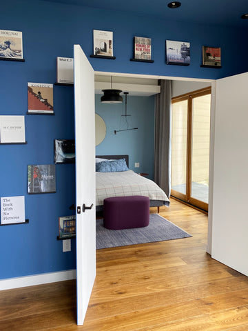 Skyhouse Airbnb hosted by Natalia Lerman featured by Kelly-Moore Paints with KM4987 Snake River a bold blue bedroom