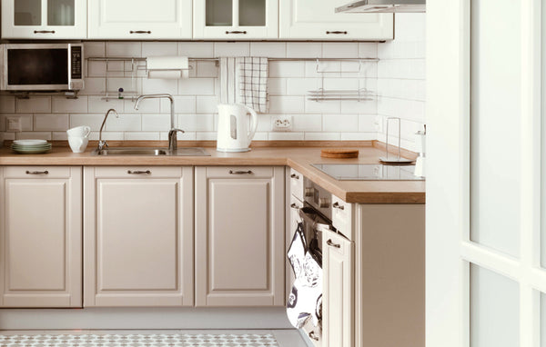 A country kitchen with a modern pink cabinet paint color to make farm style kitchens trendy