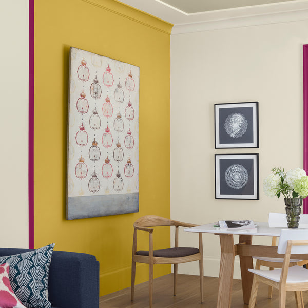 Color blocking accent feature wall in a scandi dining room with art by Shannon Kaye and Ray Beldner