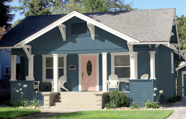 Historic bungalow craftsman style with a modern twist blue siding and pink front door
