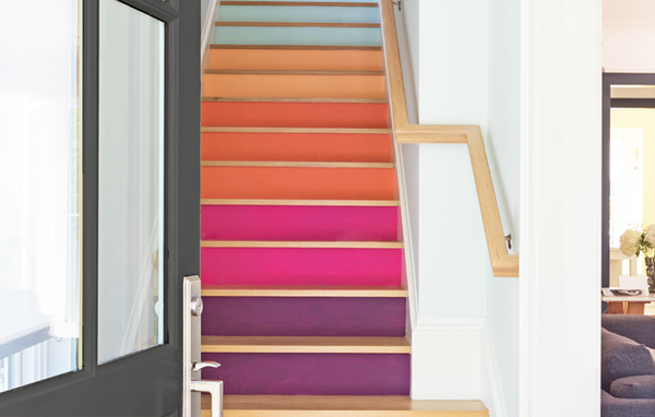 Rainbow inspired colors on a clean light wood staircase add a playful touch to stairs by Kelly-Moore Paints and Shannon Kaye