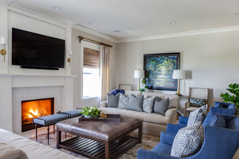 Wendy Glaister uses KM4730 Pearly Swirly for this white living room interior with blue wingback chairs and a television over the fireplace