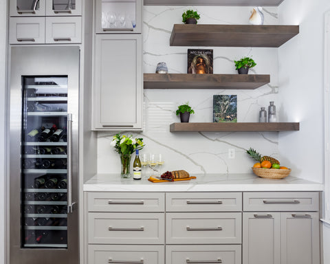 Wendy Glaister interior designer designed this gray and white kitchen with open shelving and wine refrigerator