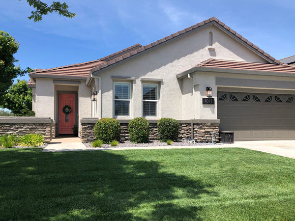Before After exterior stucco paint makeover with warm neutral brown gray paint colors and popular orange poppy pink front door color KM4425 Coral Garden
