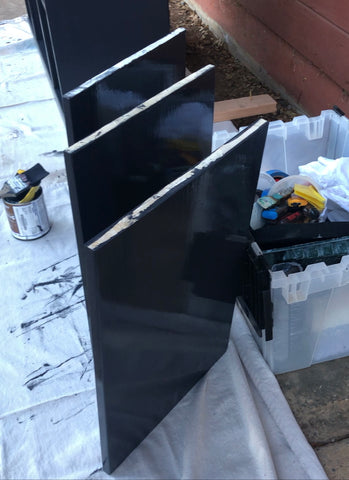 Shannon Kaye shares a paint hack with Kelly-Moore Paints to paint built-in cabinet shelves on both sides at the same time to save drying time