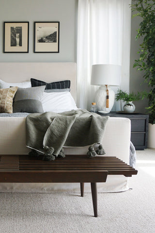 Lauren Martin-Moro tells Kelly-Moore Paints she used flat paint for neutral grey green bedroom walls