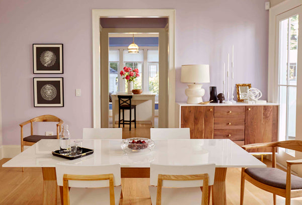 Kelly-Moore Paints features a modern lavender dining room with blue kitchen and black and white art