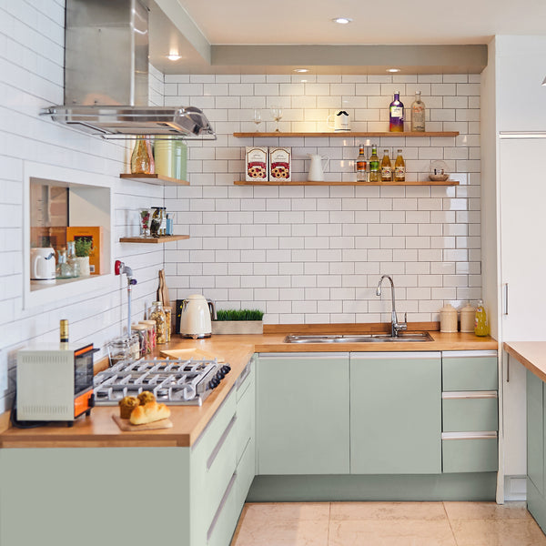 KM4830 Tree Pose for minimal retro kitchens with white tiles and cutting board countertops