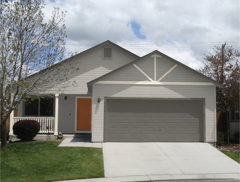 Kelly-Moore simple cottage house with gray siding dark gray garage door, white trim, gray trim, and orange door
