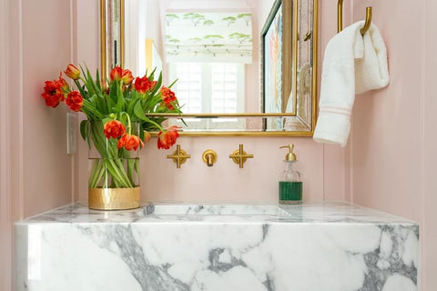 Kelly-Moore Paints features Casa Vilora Interiors founder Veronica Solomon's pink bathroom with marble counter and wall mounted gold faucet fixture