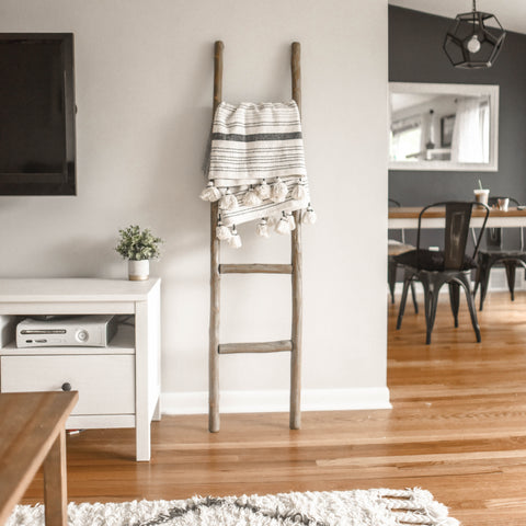 Kelly-Moore Paints neutral living room with dark dining room in black and white and natural colors
