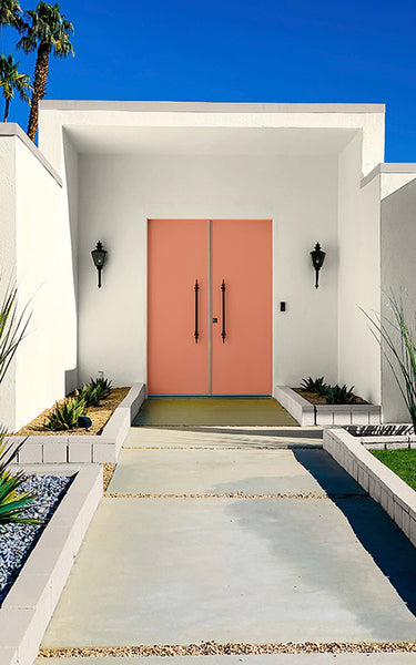 Historic paint colors on art deco midcentury modern house with pink front door by Kelly-Moore Paints