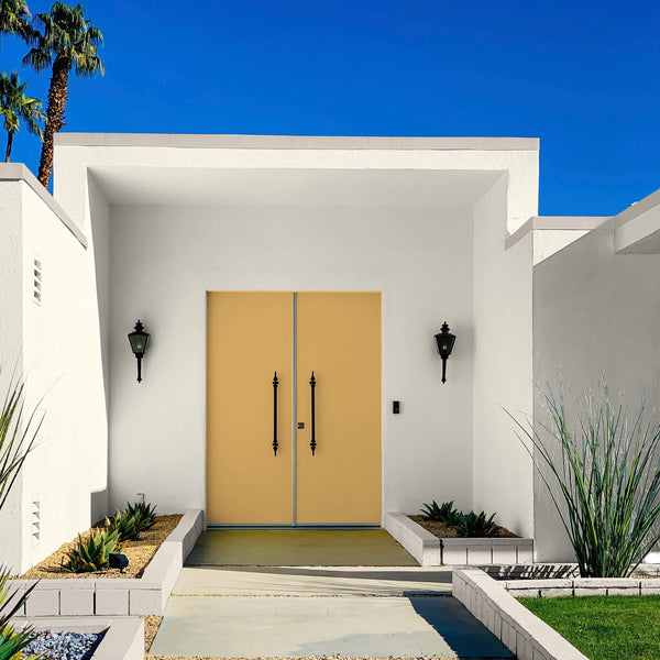 Art Deco Spanish Revival house with yellow front door featured by Kelly-Moore Paints