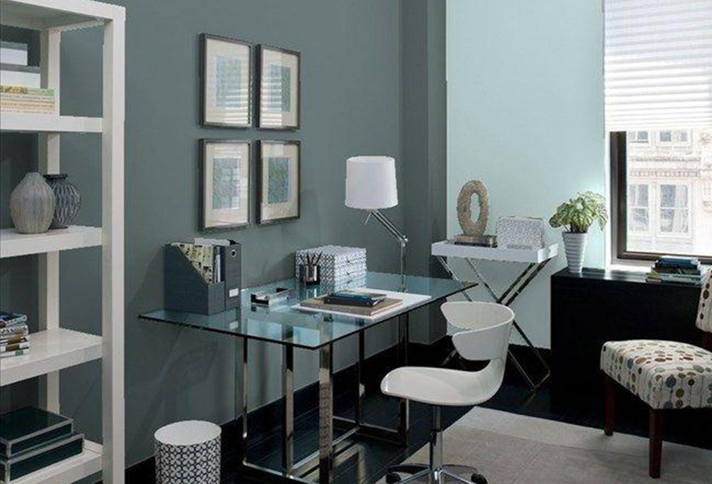 A home office painted teal and light blue.