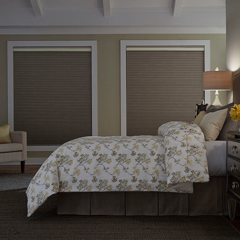 bedroom with green/beige walls and blackout shades for full light control from Regal Paint Centers