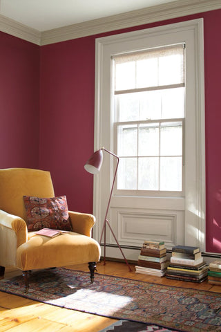 A room with walls painted with Benjamin Moore Cranberry Cocktail and trim painted with Pashmina, paint colors available at Regal Paint Centers in MD & VA.