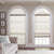 beige living room with custom arched windows and custom window coverings
