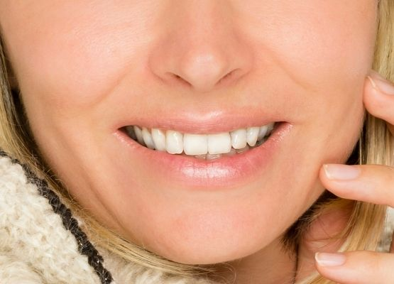 Mature woman with healthy lips due to camel milk skincare