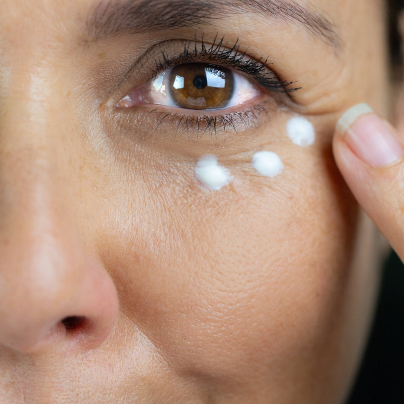 applying eye cream