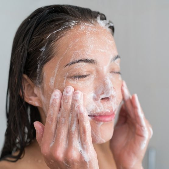 Image of woman cleansing her face with CameLife's Facial Cleansing Bar
