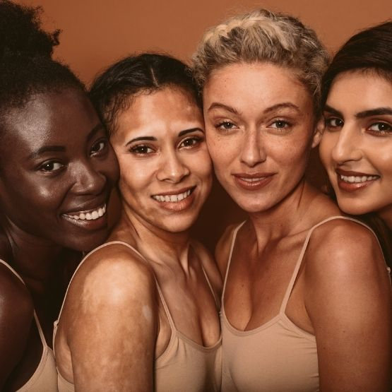Image of four women with different skin types