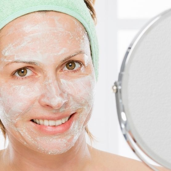 Image of a mature woman exfoliating with CameLife's Refining Facial Polish
