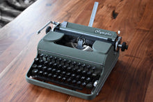 Load image into Gallery viewer, Olympia Manual Typewriter - Working Typewriter - 100% Functional - Comes with Fresh Ribbon and Original Case