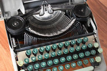Load image into Gallery viewer, Eaton's Manual Typewriter - Metallic Gray and Green - 100% Functional - Comes w/ Case and Black Ink Ribbon - Small Pica Font - Smith Corona