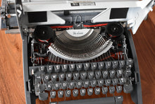Load image into Gallery viewer, Olympia DeLuxe Manual Typewriter - 100% Functional - Comes with Fresh Ribbon and Original Case - Working Typewriter