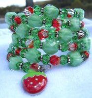 memory wire wrap bracelet -green faceted millefiori glass and red Czech bead with strawberry enameled charm