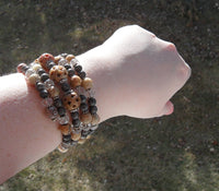 memory wire wrap bracelet - soapstone and fossil stone with clear crystal beads and lead-free pewter daisy spacers