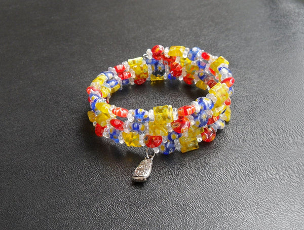 memory wire wrap bracelet - primary color red yellow blue millefiori glass and clear Czech bead with lead-free silver matryoshka doll charm