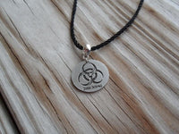 vegan charm necklace - zombie biohazard silver pewter charm on faux leather cord - 17 inch with 2 inch extender - lead and nickel free