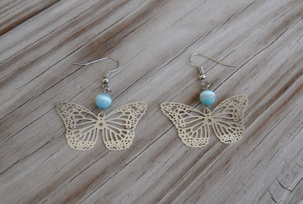 beaded dangle earrings - silver-plated brass filigree butterfly charms with sky blue fiberoptic cats eye