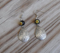 beaded dangle earrings - silver flower teardrop charm with yellow and black millefiori accent