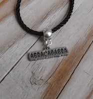 vegan charm necklace - abracadabra silver pewter charm on faux leather cord - 17 inch with 2 inch extender - lead and nickel free