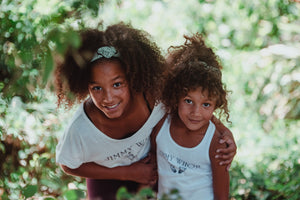 Sisters in organic cotton tank tops