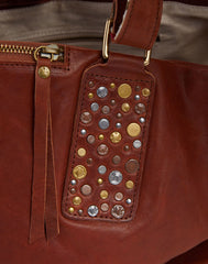 Stud Detail shot of Hammered Stud Tote in Cognac